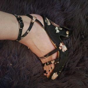 Dolce & Gabbana black shoes w/ hand sewn flowers.
